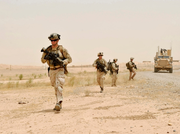 Sailors from Explosive Ordnance Disposal Mobile Unit Two move in a tactical formation during a training evolution to locate, identify, render safe and dispose of an IED, July 12, 2010