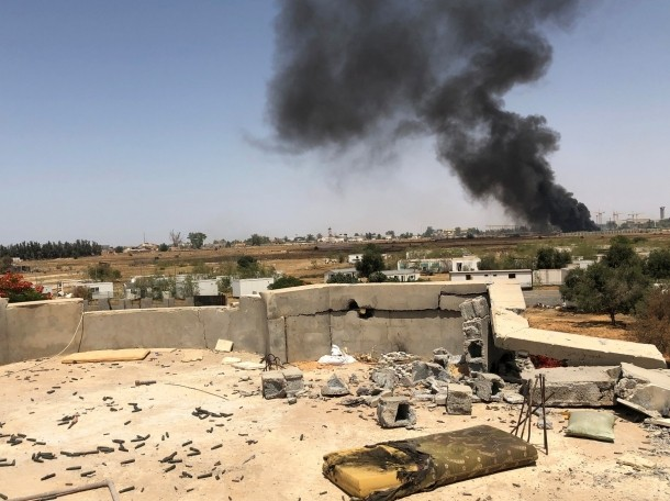 Smoke rises during a fight between members of the Libyan internationally recognized government forces and Eastern forces, in southern Tripoli, Libya June 22, 2019, photo by Yosri Aljamal/Reuters