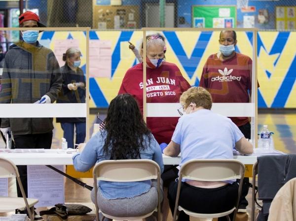 Voters prepare to cast their ballot in the Democratic primary in Philadelphia, Pennsylvania, June 2, 2020, photo by Rachel Wisniewski/Reuters