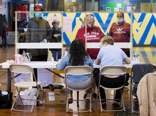 Voters prepare to cast their ballots in the Democratic primary in Philadelphia, Pennsylvania, June 2, 2020