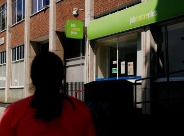 A women walks past an employment agency in London, June 16, 2020, photo by John Sibley/Reuters