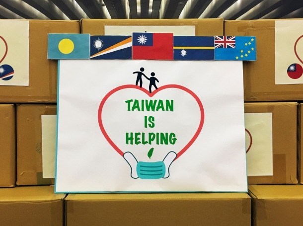 A sign with flags of (R-L) Tuvalu, Nauru, Taiwan, Marshall Islands, and Palau is seen before a ceremony to donate masks to Taiwan's Pacific allies, in Taipei, Taiwan, April 15, 2020, photo by Ben Blanchard/Reuters