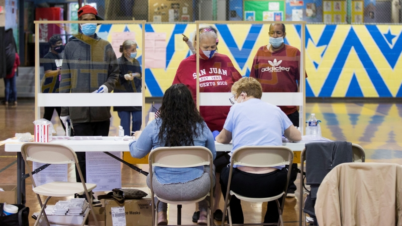 Voters prepare to cast their ballot in the Democratic primary in Philadelphia, Pennsylvania, June 2, 2020, photo by Rachel Wisniewski/Reuters