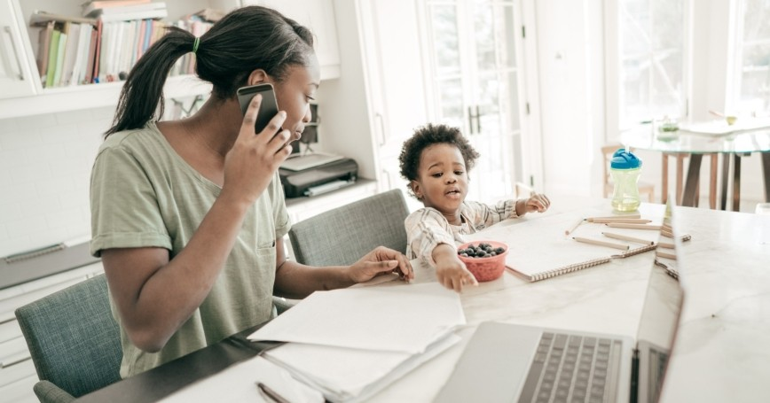Mother working at home while caring for a toddler, photo by kate_sept2004/Getty Images