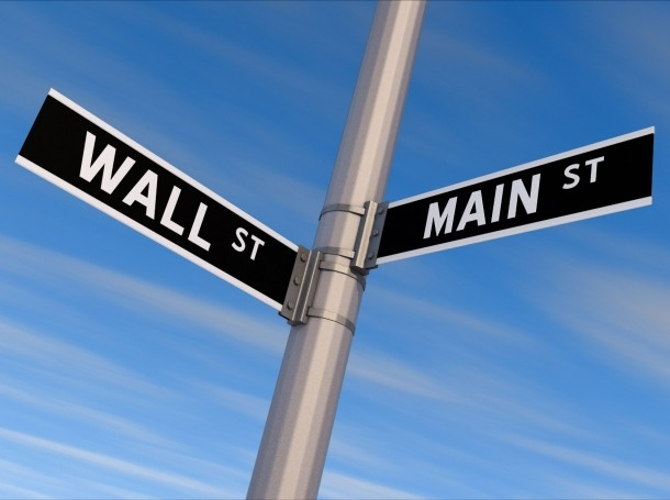 Street sign with Wall St. and Main St. signs, photo by BobHemphill/Getty Images