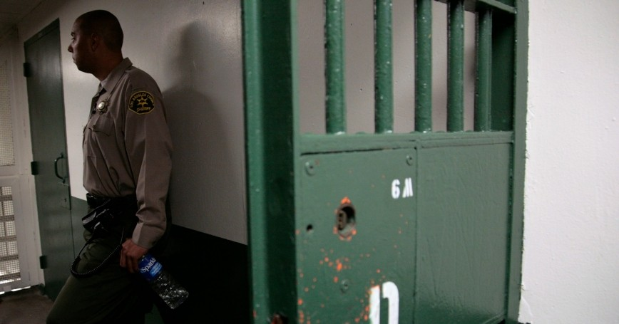 A Los Angeles County Sheriff's deputy stands watch at Men's Central Jail in Los Angeles, California, October 3, 2012, photo by Jason Redmond/Reuters