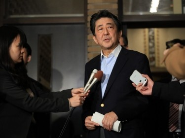 Japan's Prime Minister Shinzo Abe speaks to the media after having a telephone discussion with U.S. President Donald Trump, in Tokyo, December 21, 2019, photo by Koji Ito/Reuters
