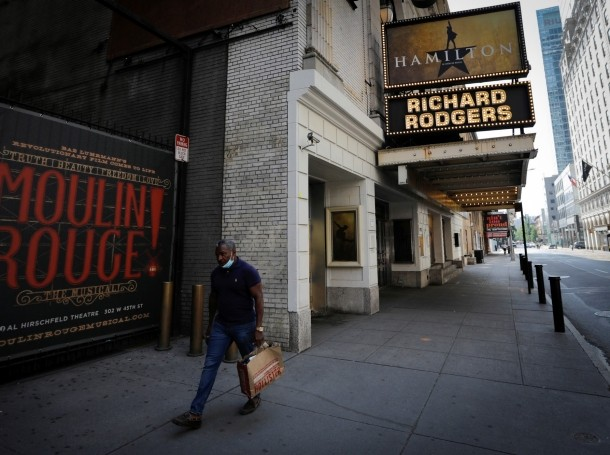 """A man walks past the shuttered Richard Rodgers Theatre, home of the popular musical """"Hamilton,"""" in New York, July 2, 2020, photo by Mike Segar/Reuters"""