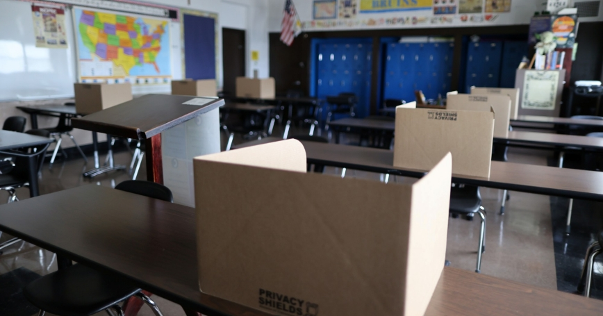 Social distancing dividers for students in a classroom at St. Benedict School in Montebello, near Los Angeles, California, July 14, 2020, photo  by Lucy Nicholson/Reuters