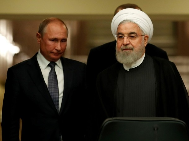 Presidents Hassan Rouhani of Iran and Vladimir Putin of Russia arrive for a news conference in Ankara, Turkey, September 16, 2019, photo by Umit Bektas/Reuters