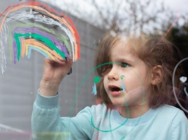 6-year-old Alice Young uses chalk pens to draw a rainbow on her window, in Wimbledon, UK, April 3, 2020, photo by Katie Collins/Reuters