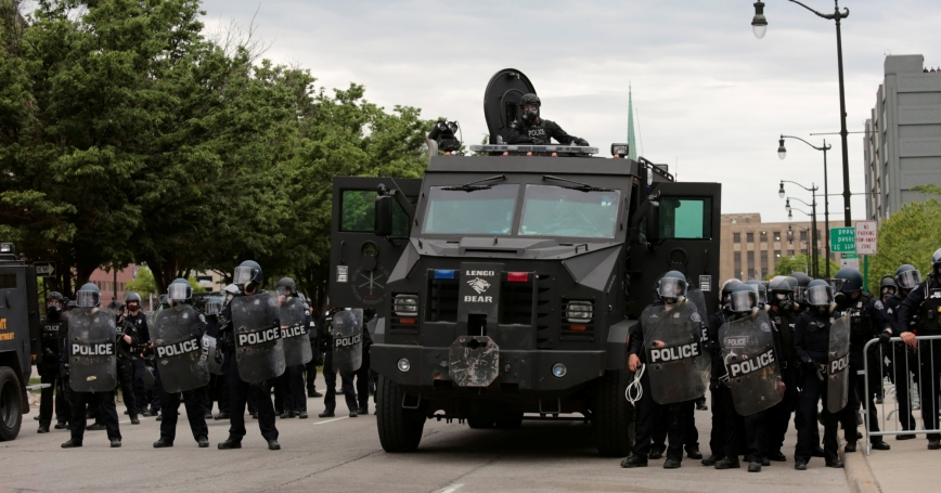 Detroit police line up next to an armored vehicle following a rally against the death in Minneapolis police custody of George Floyd, in Detroit, Michigan, June 1, 2020, photo by Rebecca Cook/Reuters