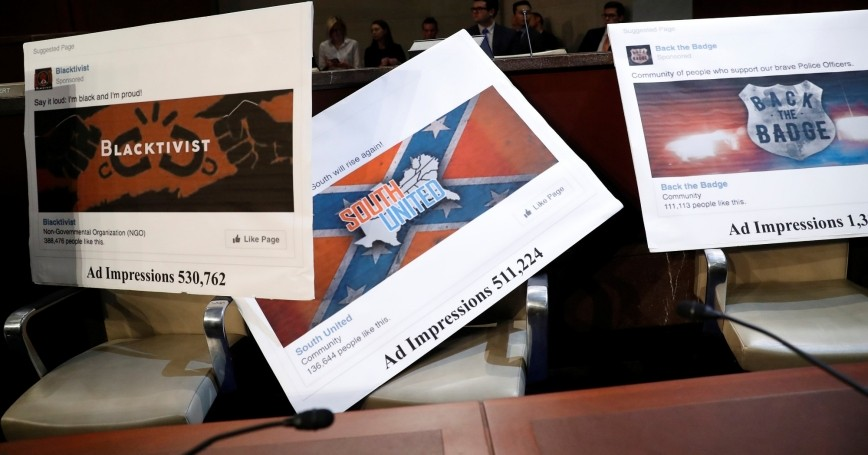 Examples of Facebook pages displayed during a House Intelligence Committee meeting on Russian use of social media to influence U.S. elections in Washington, D.C., November 1, 2017, photo by Aaron P. Bernstein/Reuters