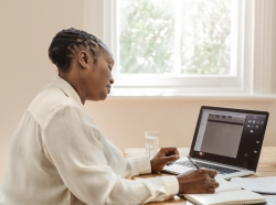 Mature Black women working on a computer at home, photo by Goodboy Picture Company/Getty Images
