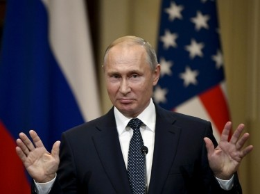 Russia's President Vladimir Putin gestures during the joint press conference with U.S. President Donald Trump in the Presidential Palace in Helsinki, Finland, July 16, 2018, photo by Lehtikuva/Jussi Nukari/Reuters