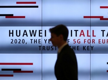 "A man attends the ""2020, The Year of 5G for Europe"" conference at the the Huawei Cyber Security Transparency Centre in Brussels, Belgium, January 16, 2020, photo by Yves Herman/Reuters"