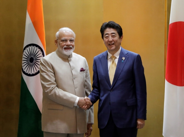 India's prime minister Narendra Modi shakes hands with Shinzo Abe, Japan's prime minister, during a bilateral meeting in Osaka, Japan, June 27, 2019, photo by Kiyoshi Ota/Reuters