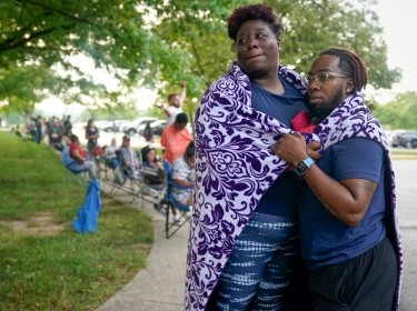Whitney Maddox and DeShaun Bradford stand in line with hundreds of others outside a career center in Frankfort, Kentucky, hoping for assistance with their unemployment claim, June 18, 2020, photo by Bryan Woolston/Reuters
