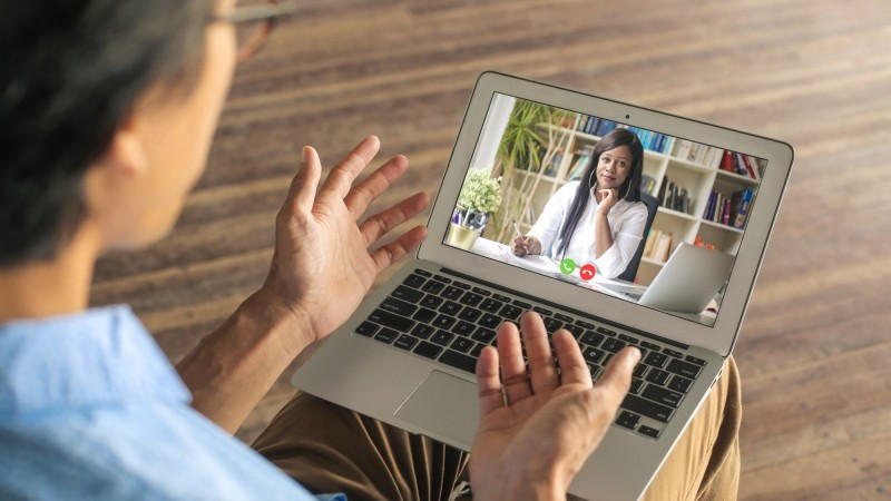 Man speaking to his psychologist via telemedicine, photo by Merlas/Getty Images