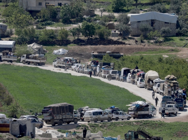Internally displaced Syrians drive back to their homes, as some people are afraid of the COVID-19 outbreak in crowded camps, in Dayr Ballut, Syria, April 11, 2020, photo by Khalil Ashawi/Reuters