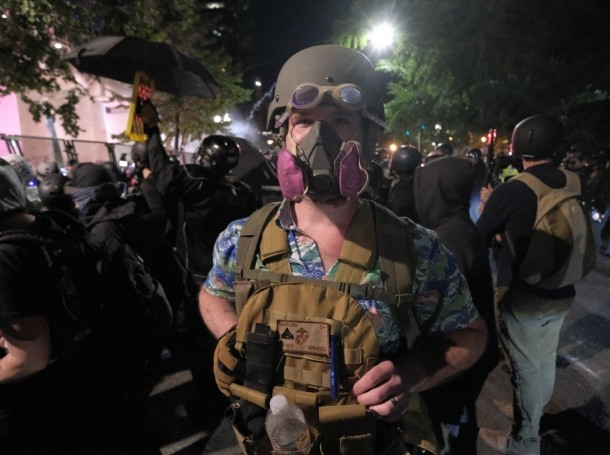 A Boogaloo Boy stands with protesters demanding that federal officers leave the federal courthouse in Portland, Ore., on July 25, 2020, photo by Alex Milan Tracy/Sipa USA via Reuters