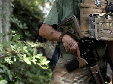 A member of the Three Percent militia in downtown Stone Mountain, Georgia, where various militia groups stage rallies, August 15, 2020, photo by Dustin Chambers/Reuters