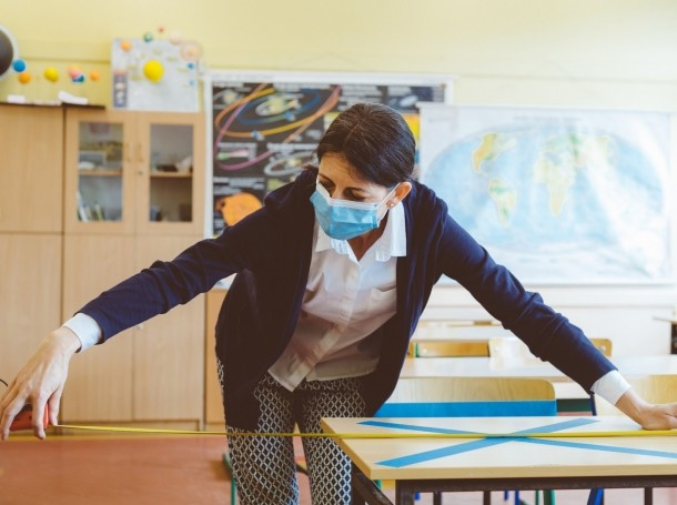 A teacher preparing classroom for social distancing, photo by izusek/Getty Images