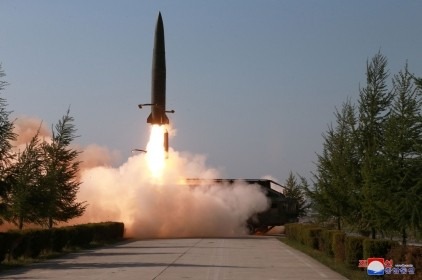 A missile is seen launched during a military drill in North Korea, May 10, 2019, photo by Korean Central News Agency via Reuters