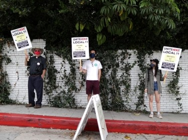 People socially distance as they protest in support of laid-off hotel workers without health care amid the COVID-19 pandemic, in Los Angeles, California, July 23, 2020, photo by Lucy Nicholson/Reuters