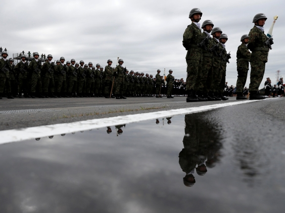 Members of Japan's Self-Defence Forces' airborne unit attend the annual SDF ceremony at Asaka Base in Asaka, north of Tokyo, Japan, October 14, 2018, photo by Kim Kyung-Hoon/Reuters