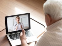 Man talking with his doctor online, photo by fizkes/Getty Images