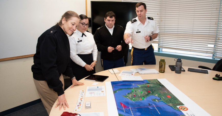Naval War College President Rear Adm. Shoshana Chatfield, left, views the wargaming hub at the college's Naval Postgraduate School program in Monterey, CA, January 29, 2020, photo by Javier Chagoya/U.S. Navy