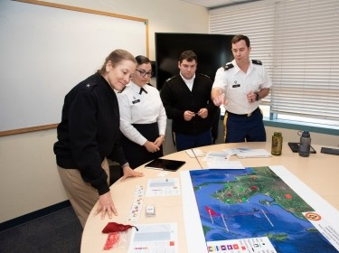Naval War College President Rear Adm. Shoshana Chatfield, left, visits the NWC Monterey program, in Monterey, CA, January 29, 2020, photo by Javier Chagoya/U.S. Navy