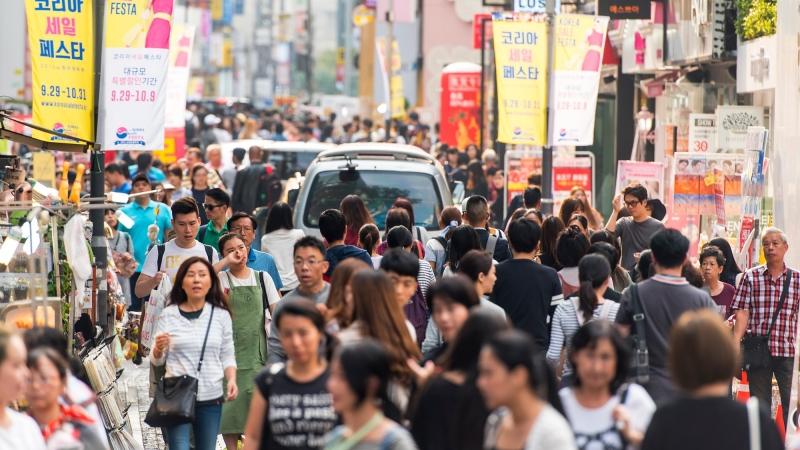 A crowded street in Seoul, South Korea, photo by AlxeyPnferov/Getty Images