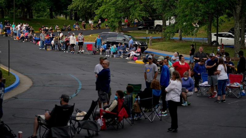 People line up outside Kentucky Career Center prior to its opening to find assistance with their unemployment claims in Frankfort, Kentucky, June 18, 2020, photo by Bryan Woolston/Reuters