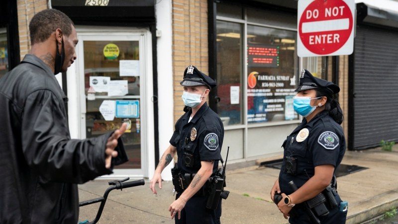 Camden County Police officers patrol on the streets of Camden, New Jersey, amid nationwide protests in the aftermath of the death in Minneapolis police custody of George Floyd, June 11, 2020, photo by Jessica Kourkounis/Reuters