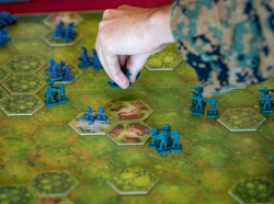 A U.S. Marine with the 3rd Marine Division moves game pieces during a game of Memoir 44' on Camp Schwab, Okinawa, Japan, Dec. 10, 2019