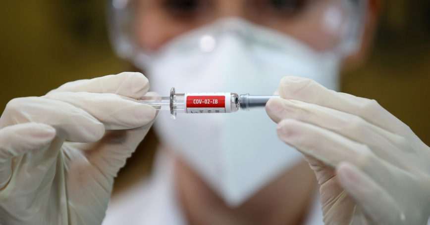 A nurse holds China's Sinovac COVID-19 vaccine at a hospital in Porto Alegre, Brazil, August 8, 2020, photo by Diego Vara/Reuters