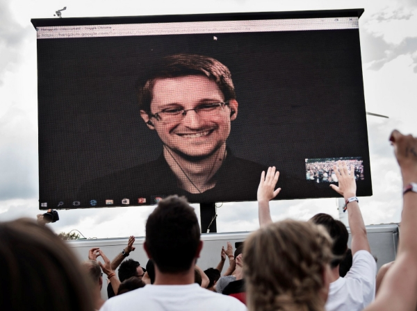 American whistleblower Edward Snowden is seen on a screen as he delivers a speech during the Roskilde Festival in Roskilde, Denmark, June 28 2016, photo by Scanpix Denmark/Mathias Loevgreen Bojesen/via Reuters