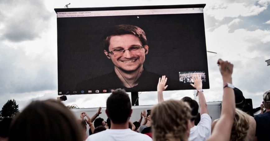 American whistleblower Edward Snowden is seen on a screen as he delivers a speech during the Roskilde Festival in Roskilde, Denmark, June 28 2016, photo by Scanpix Denmark/Mathias Loevgreen Bojesen/via Reuters