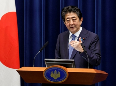 Japanese Prime Minister Shinzo Abe speaks at a news conference at the prime minister's official residence in Tokyo, Japan, June 18, 2020, photo by Rodrigo Reyes Marin/Reuters