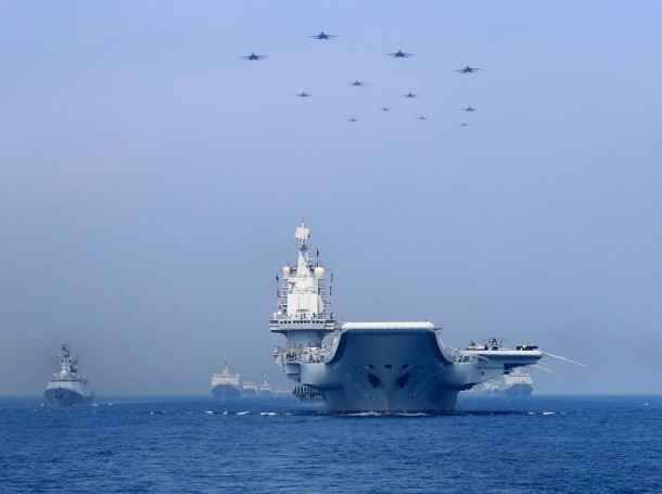 Chinese People's Liberation Army (PLA) Navy warships and fighter jets take part in a military display in the South China Sea, April 12, 2018