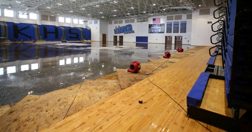 Flood waters inside the gymnasium at C.E. King High School following tropical storm Harvey in Houston, Texas, September 8, 2017, photo by Mike Blake/Reuters