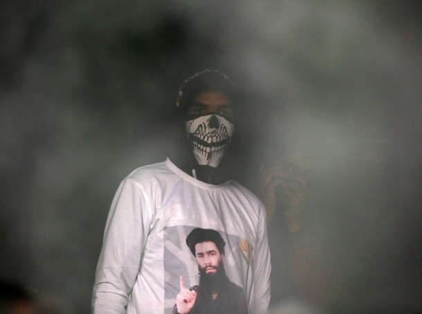 A man wearing a t-shirt with an image of Zakir Rashid Bhat, the leader of an al Qaeda affiliated militant group in Kashmir, in Dadasara, Kashmir, May 24, 2019, photo by Danish Ismail/Reuters