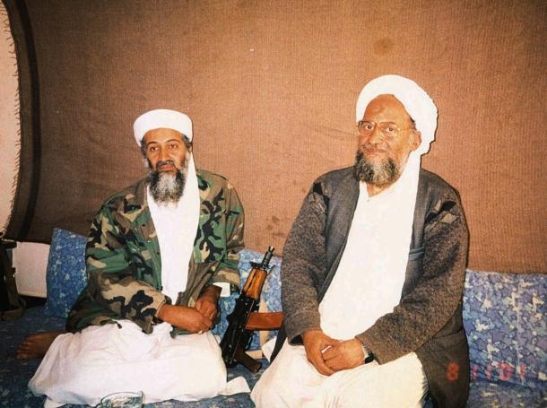 Osama bin Laden (L) sits with his adviser Ayman al-Zawahiri, in a secret location in Afghanistan, November 10, 2001, photo by Hamid Mir/Reuters