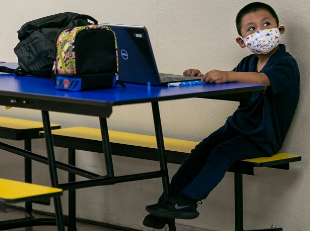 A child attends Miami Community Charter School for the first day of class in Flagler City, Florida, August 31, 2020, photo by Matias J. Ocner/Miami Herald/TNS/ABACA/Reuters
