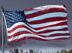 USA flag over NYC skyline, photo by franckreporter/Getty Images
