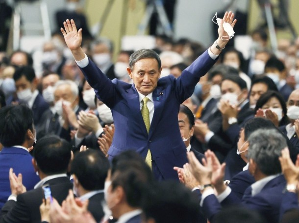Japanese Chief Cabinet Secretary Yoshihide Suga gestures as he is elected as new head of Japan's ruling party paving the way for him to replace Prime Minister Shinzo Abe, in Tokyo, Japan, September 14, 2020, photo by KYODO/Reuters