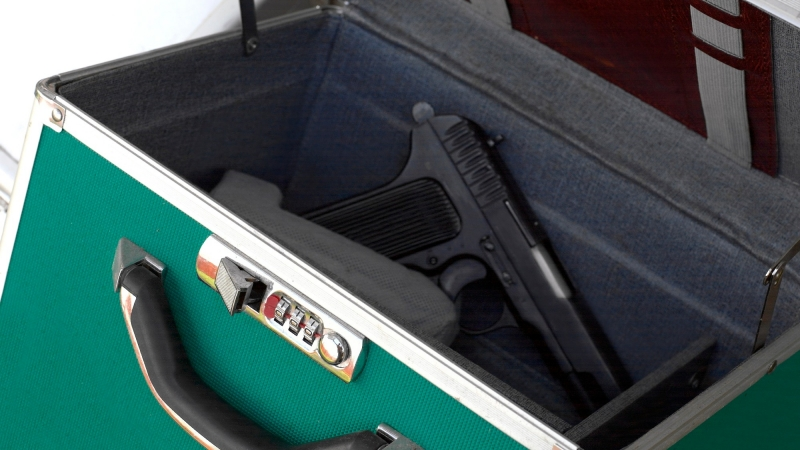 Gun in open lock box, photo by victorass88/Getty Images
