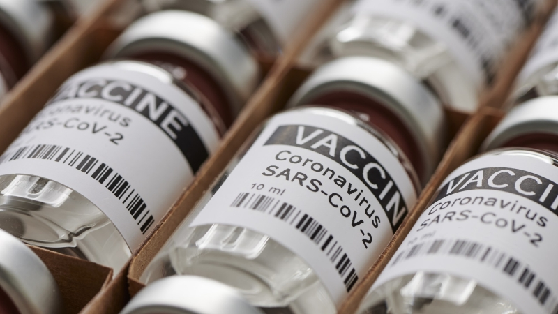 Bottles containing a vaccine for SARS-CoV-2, photo by Max Rode/Adobe Stock